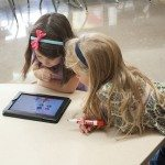 young girls with iPad