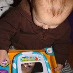 baby with toy tablet