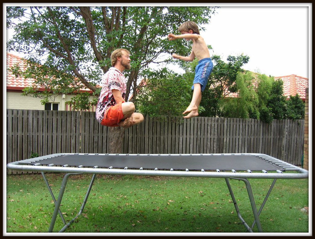 dad and son on trampoline