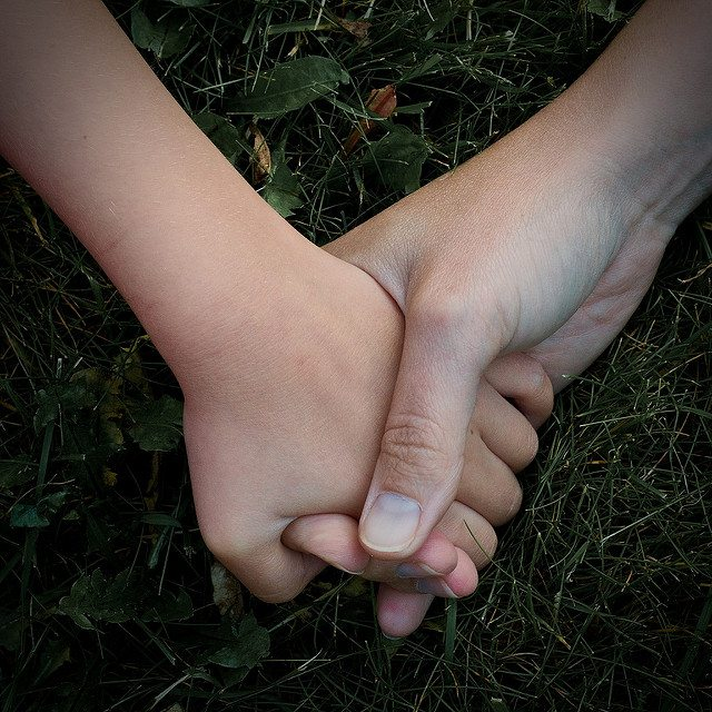 holding a child's hand