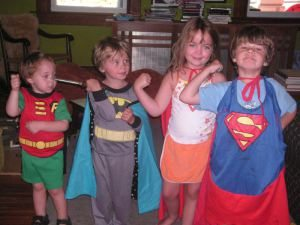 kids pretending to be superheroes