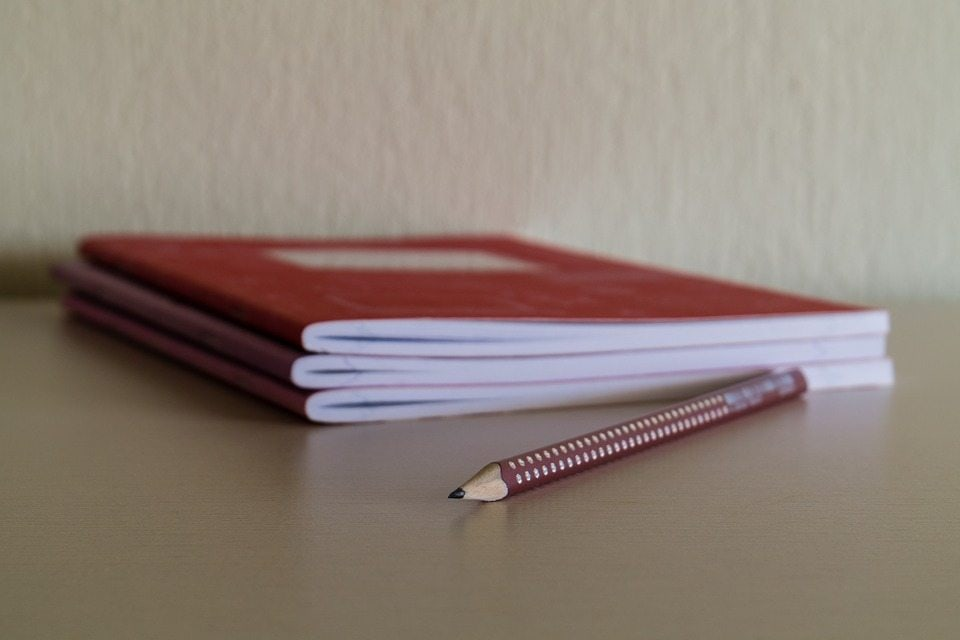 notebooks and pencil