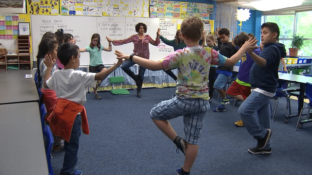kids doing yoga in classroom