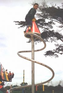 child climbing at Dennis the Menace Park