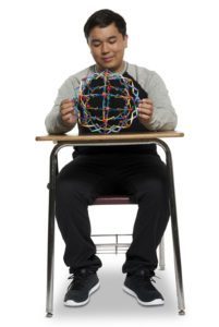 student at desk with breathing sphere