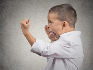 boy yelling and shaking fist