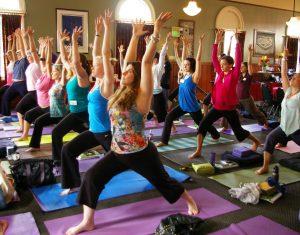 Warrior I pose in Yoga Calm training