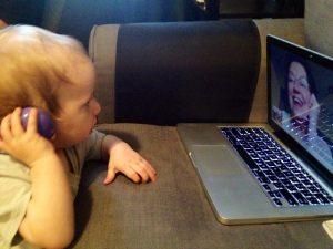 toddler talking to grandma via computer