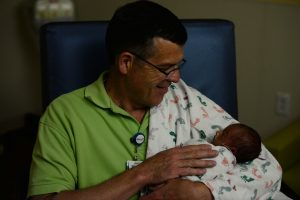volunteer cuddling newborn