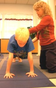 Lynea Gillen teaching plank pose