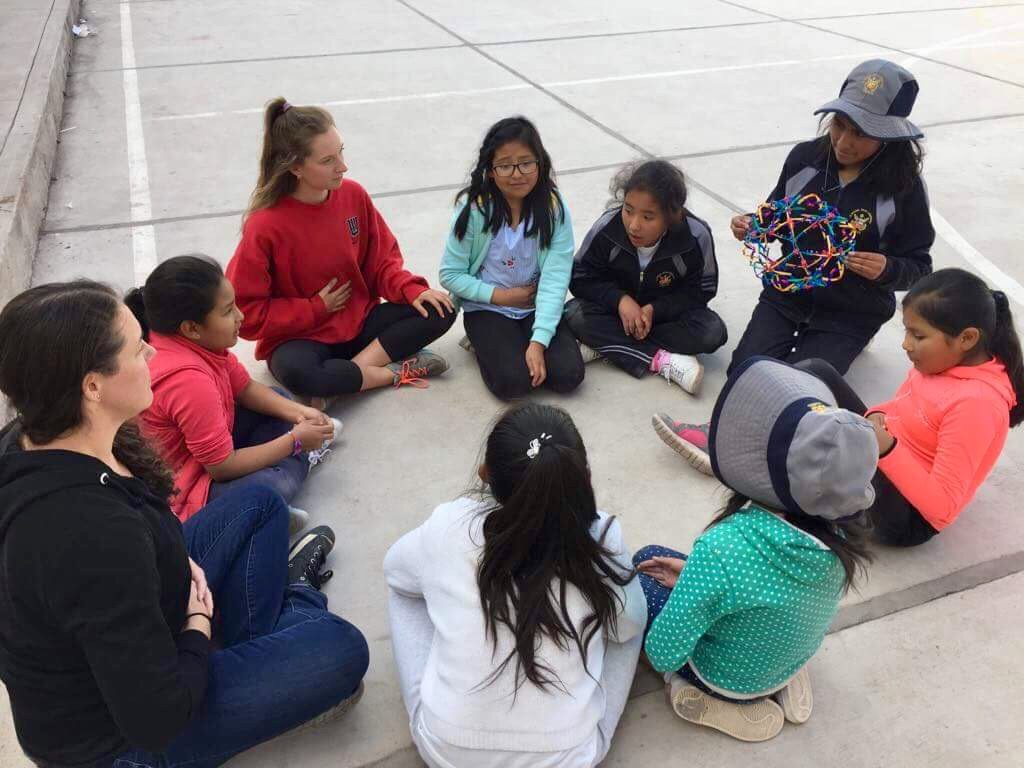 circle of students using breathing sphere
