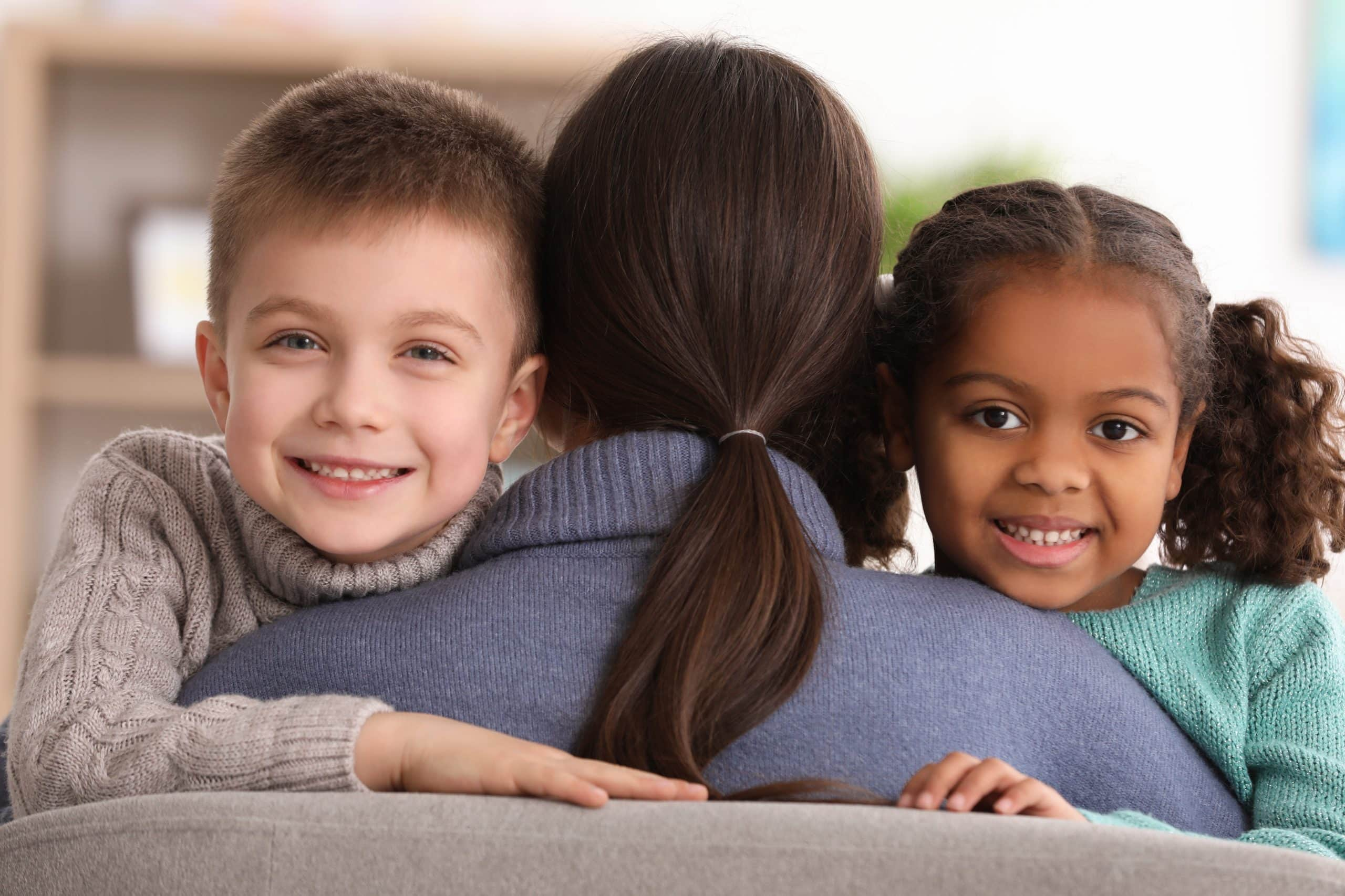 caregiver hugging kids