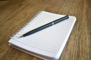 pen on blank notebook