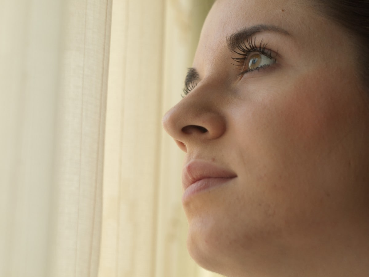 woman looking up thoughtfully