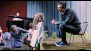 Fred Rogers listening to girl