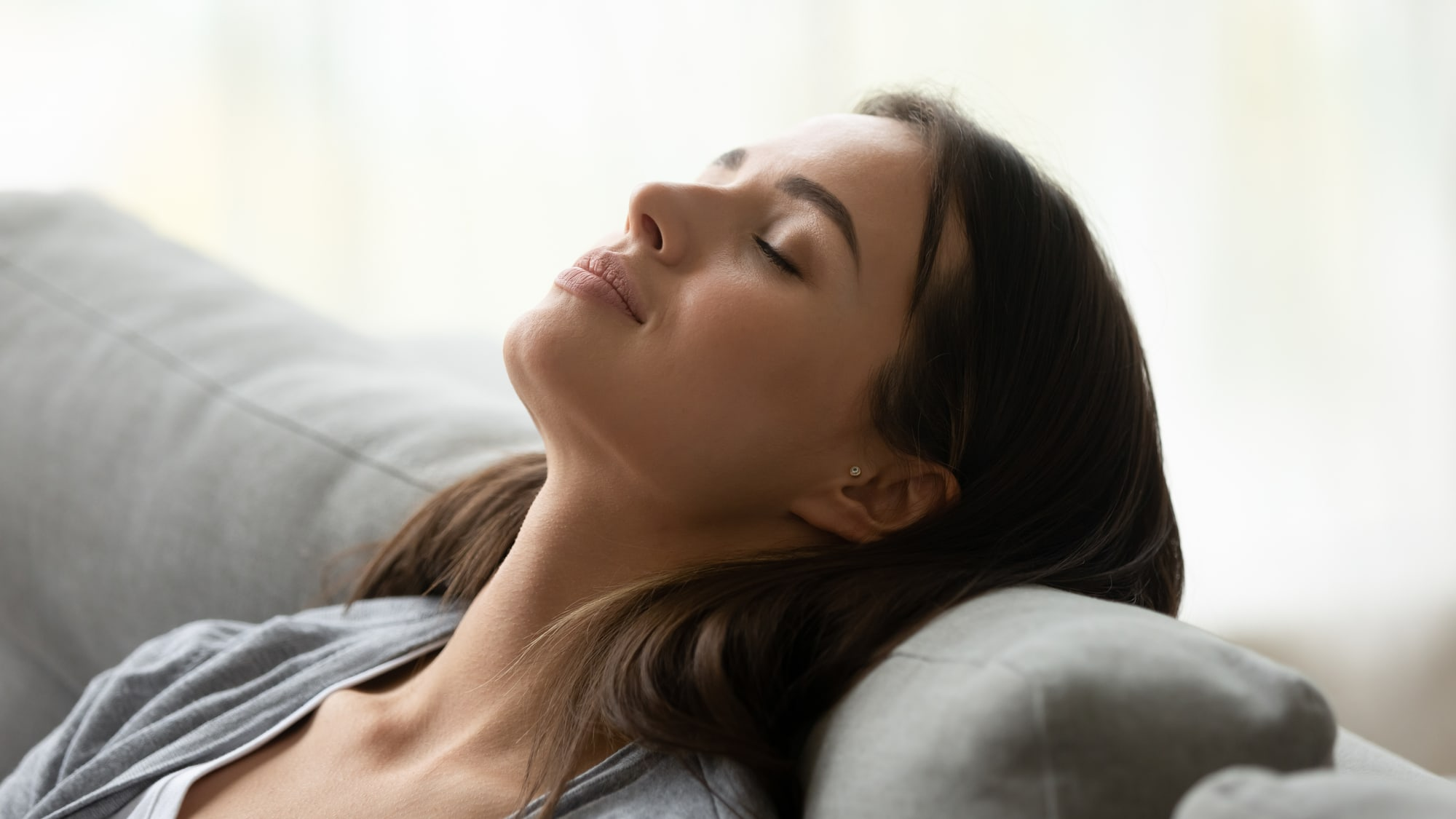 woman lying back with eyes closed