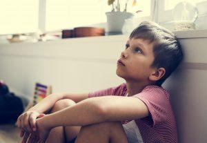 boy gazing blankly