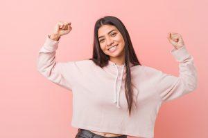 teen girl flexing muscles